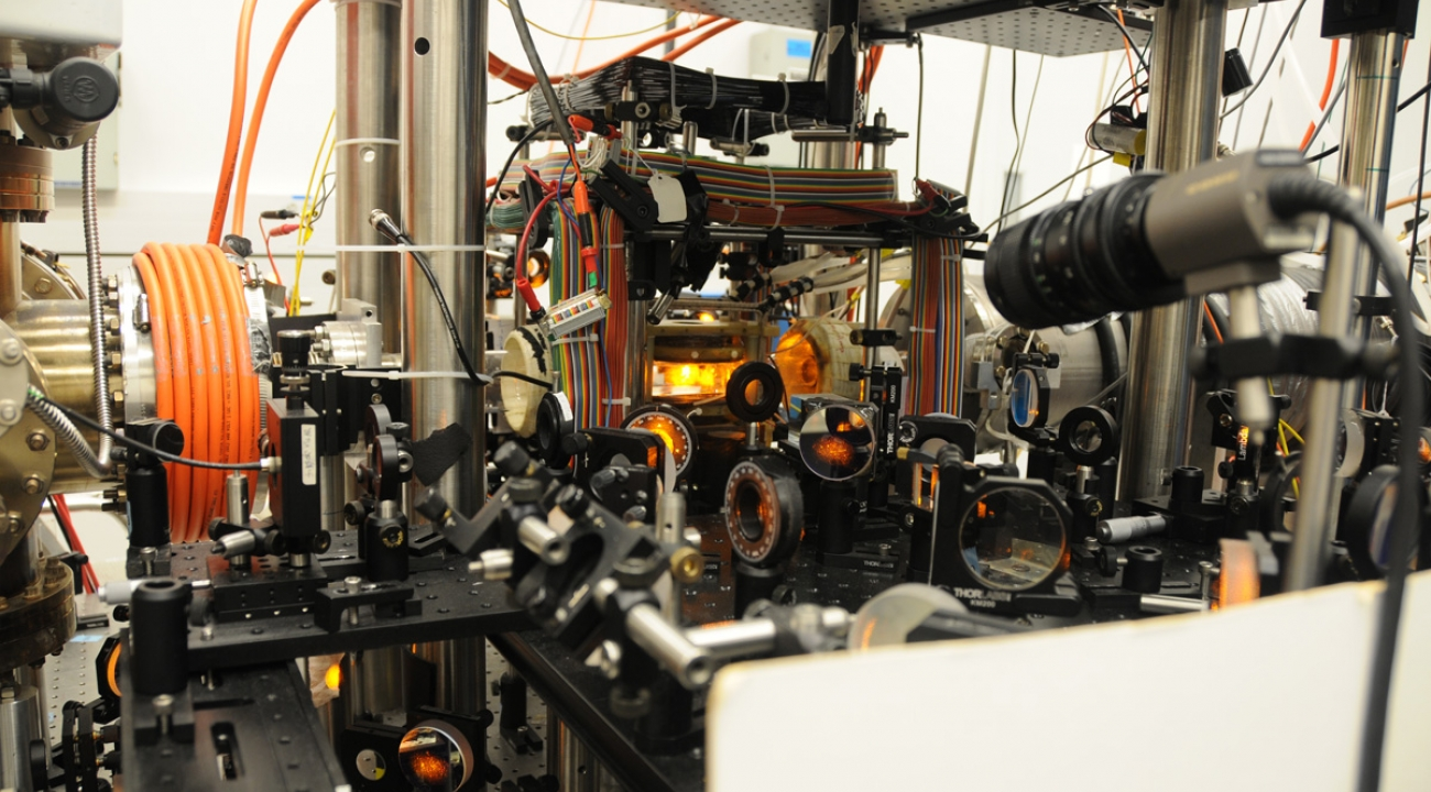 Want to create a sizable cloud of sodium atoms, seen glowing (close-up in inset above) in JQI Fellow Kris Helmerson's lab? You'll need a furnace (Fig. b) that produces a steady stream of atoms (Fig. c). Eventually they end up trapped in an ultrahigh- vacuum enclosure (Fig. a) for detailed study.