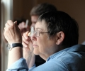 Sarah Wendel works on focusing with two hand-held lenses, JQI