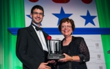 Jacob Taylor receives 2012 Service to America award.