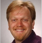 Headshot of Trey Porto, JQI Fellow